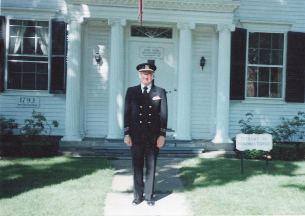 Hank Anderson in his Navy uniform outside Cramer & Anderson's flagship office in New Milford.