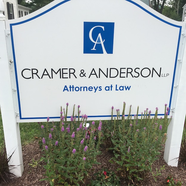 The Cramer & Anderson sign at the flagship office in New Milford. The firm is seeking a Litigation Associate.