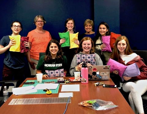 Ridgefield Woman's Club members Joan Stefura and Karen Heidinger with the young women of the Lion's Heart Class of 2020 Red Group. They worked together to make comfort pillows for breast cancer patients.