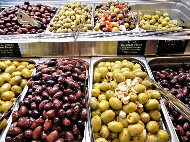 Olives in a salad bar at a supermarket.