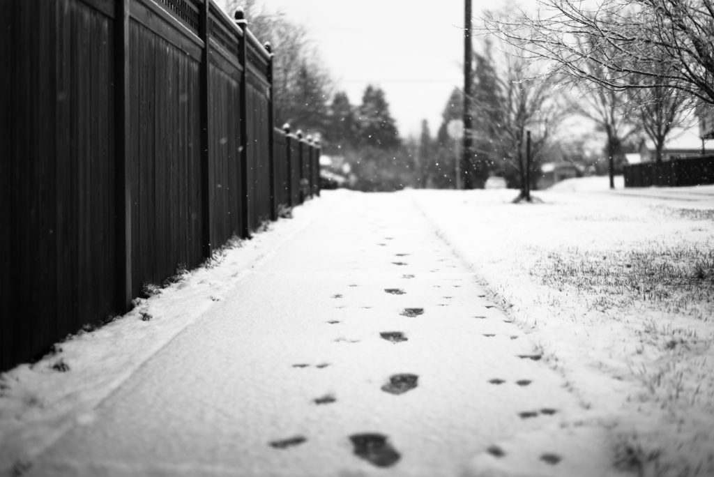 A sidewalk covered in snow; Connecticut snow and ice slip-and-fall injuries.